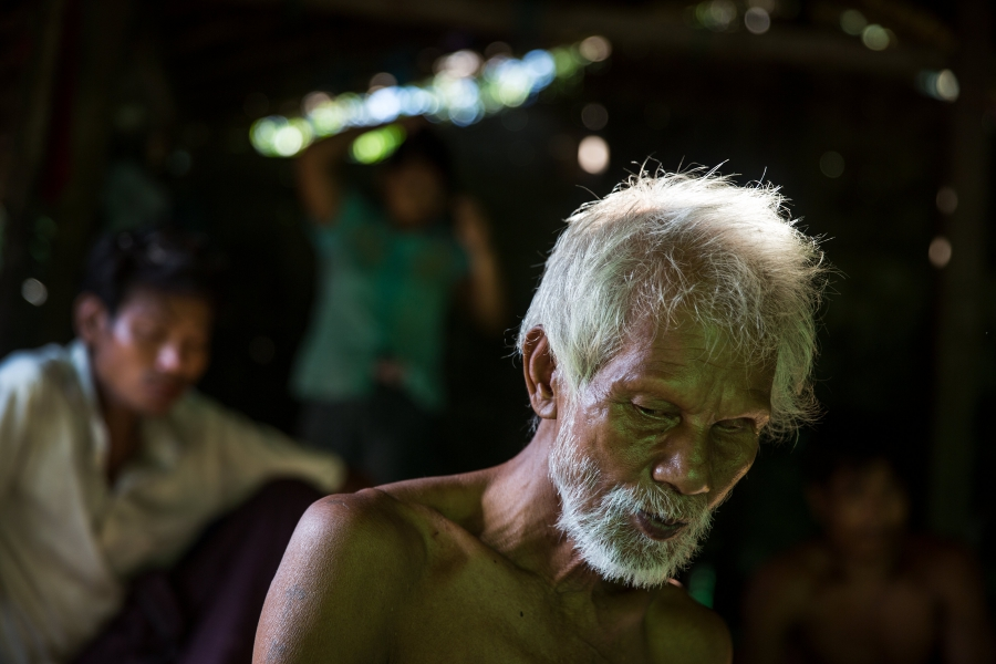 U Hla Myint, 65, sits in his home at a small village where migrant workers for Supowin Palm Oil live outside Kawthaung, Myanmar, Nov.14, 2016. Myint and his wife retired five years ago. They're now supported by two sons.