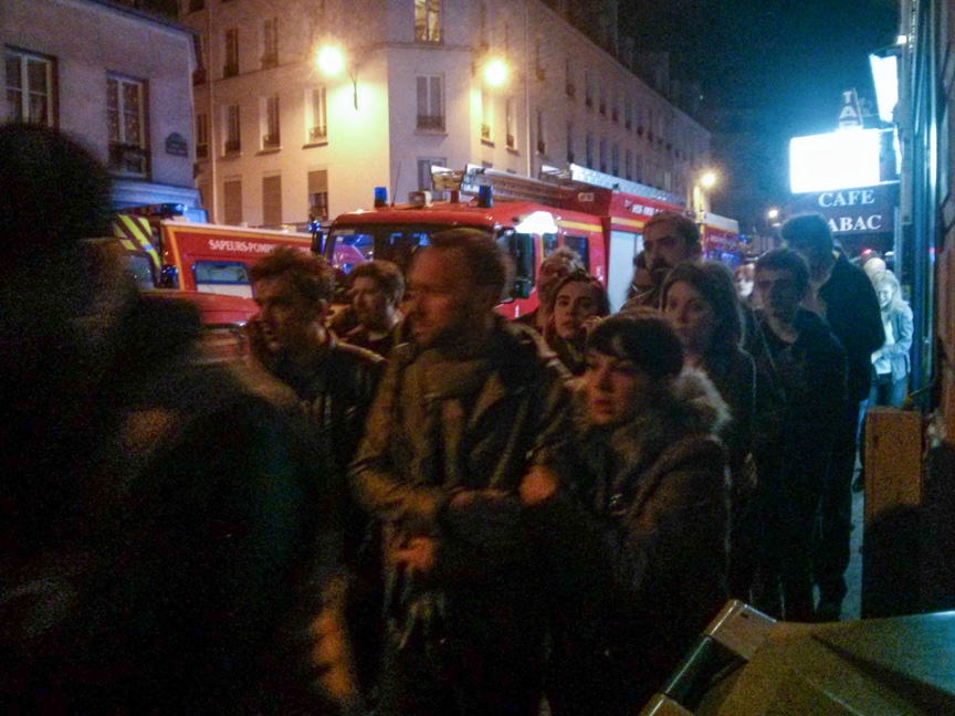 Concert-goers and bystanders outside the Bataclan concert hall after the attack on the Bataclan Friday night.