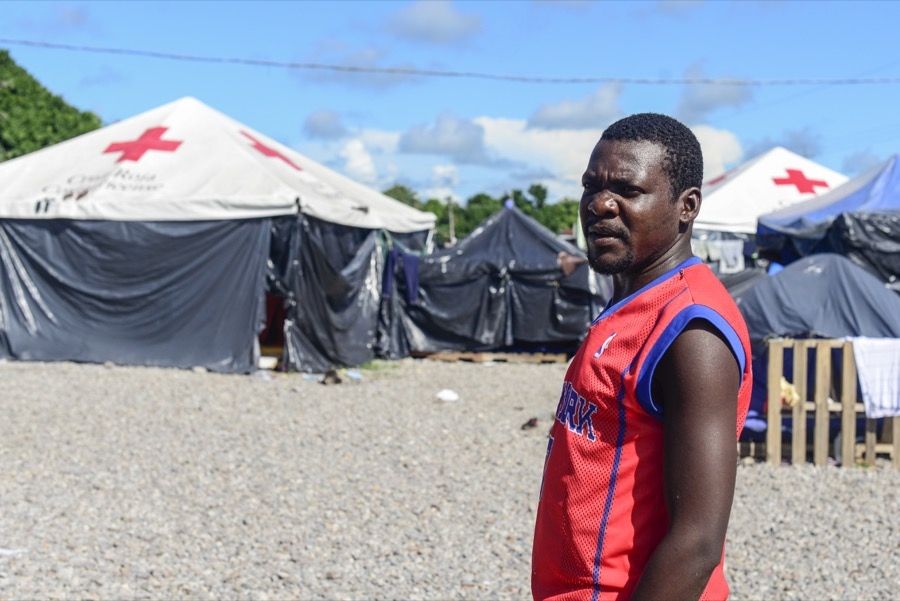 A migrant stands in a makeshift camp set up by the Red Cross in Paso Canoas, near Costa Rica's border with Panama.