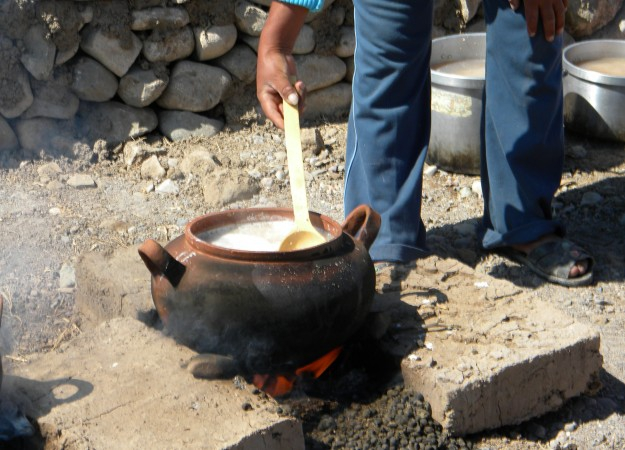 hicha is cooked over a llama-dung fire. When the water boils, a thick mixture of water and ground corn is added to the brewing vessel. Photo courtesy of the Cerro Baul Archaeological Project