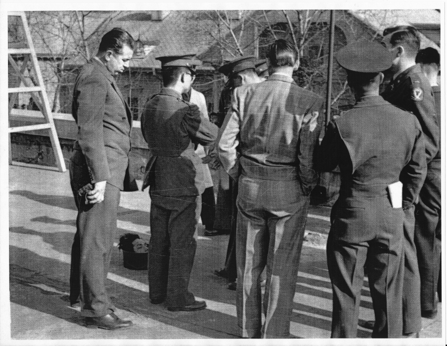 Nichols is seen here (far left) standing above severed human head, alongside unidentified US and South Korean officials in Seoul. Severed heads of Communist guerilla leaders were often sent to the South Korean capital to show progress in the civil war, Ha