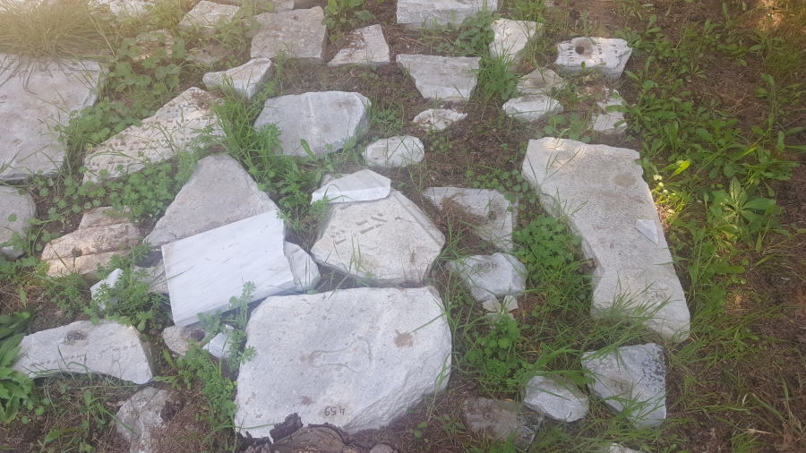 Small fragments of tombstones from Thessaloniki's old Jewish cemetery. The pieces are too small to decipher.