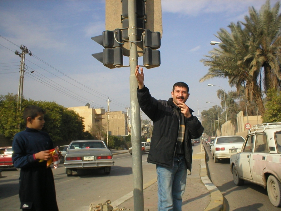 Ayub, fed up with congestion at an especially busy Baghdad intersection, jumped out of the car to direct traffic.