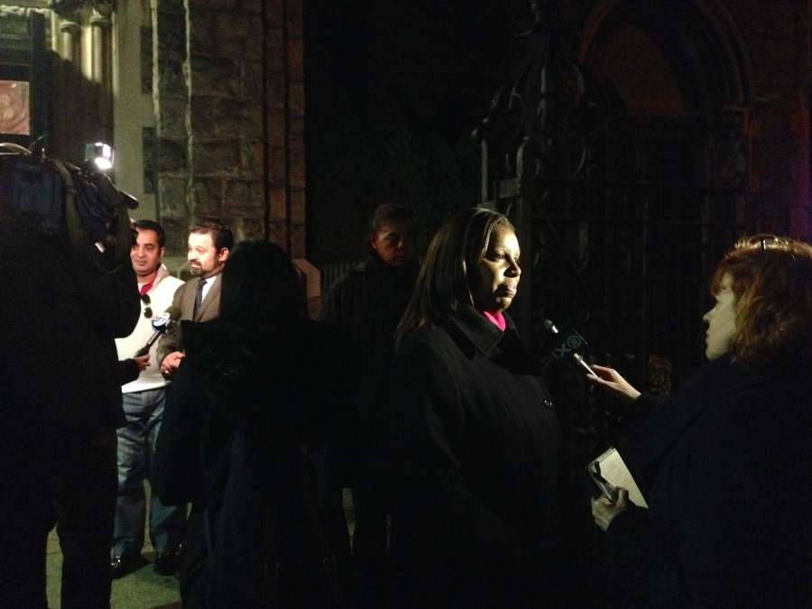 After an interfaith service in Brooklyn, TV news crews interview Mohammad Razvi (left back) and Letitia James (right front), who's Public Advocate for the City of New York. (The World/Julia Barton)