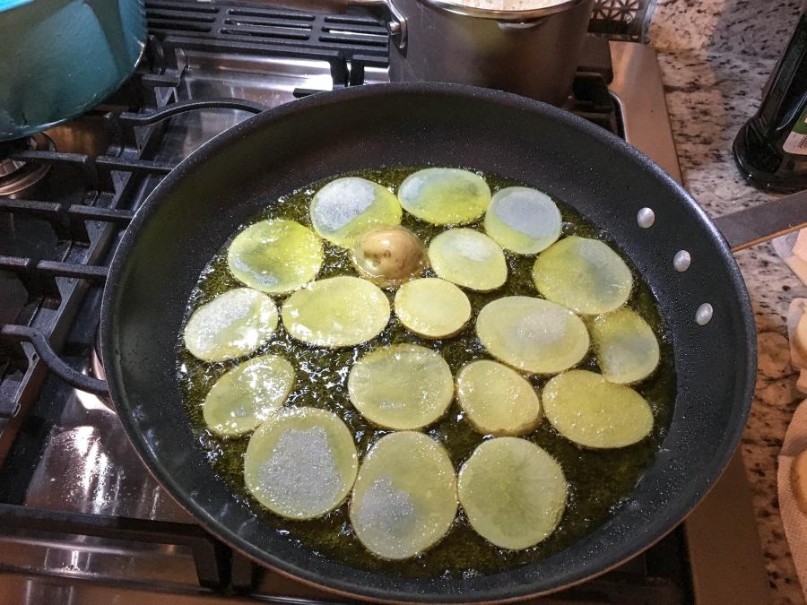 Potatoes fry in a pan at Amanda Saab's kitchen.