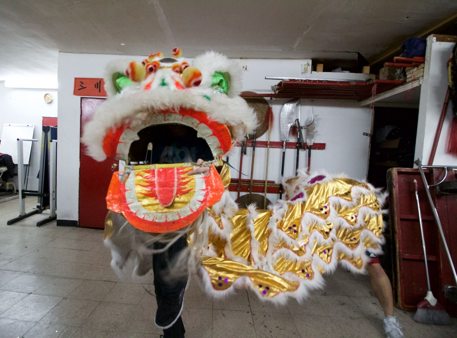 Dancers are supposed to control the lion head's ears and eyes by manipulating four strings with one hand, while the other supports and moves the head.