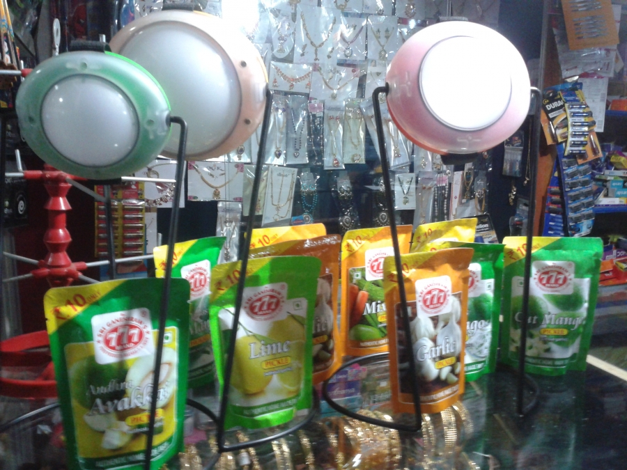 Essmart's solar lamps on display along with a range of Indian pickles at a local store in Tamil Nadu.