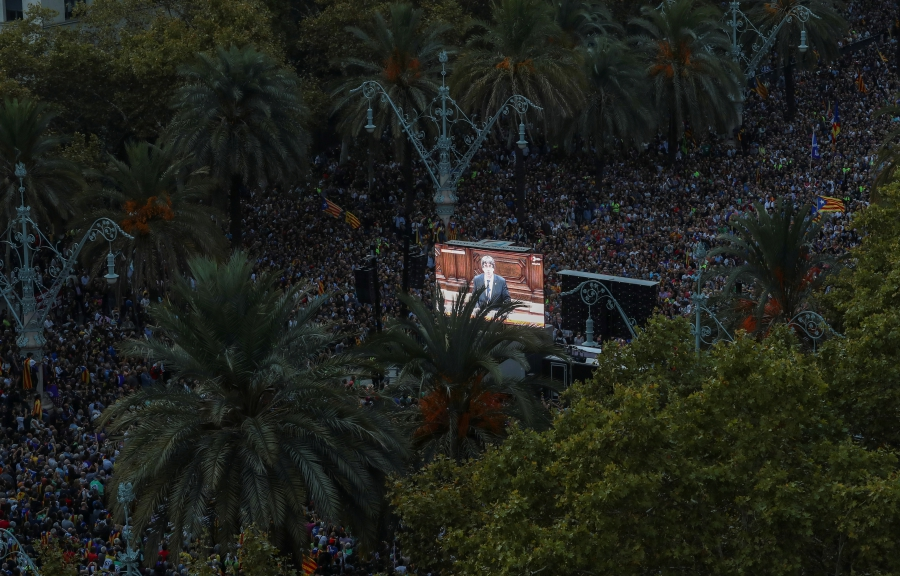 People watch Catalan President Carles Puigdemont address the regional parliament while they attend a pro-indpendence rally near the Catalan regional parliament in Barcelona, October 10, 2017.