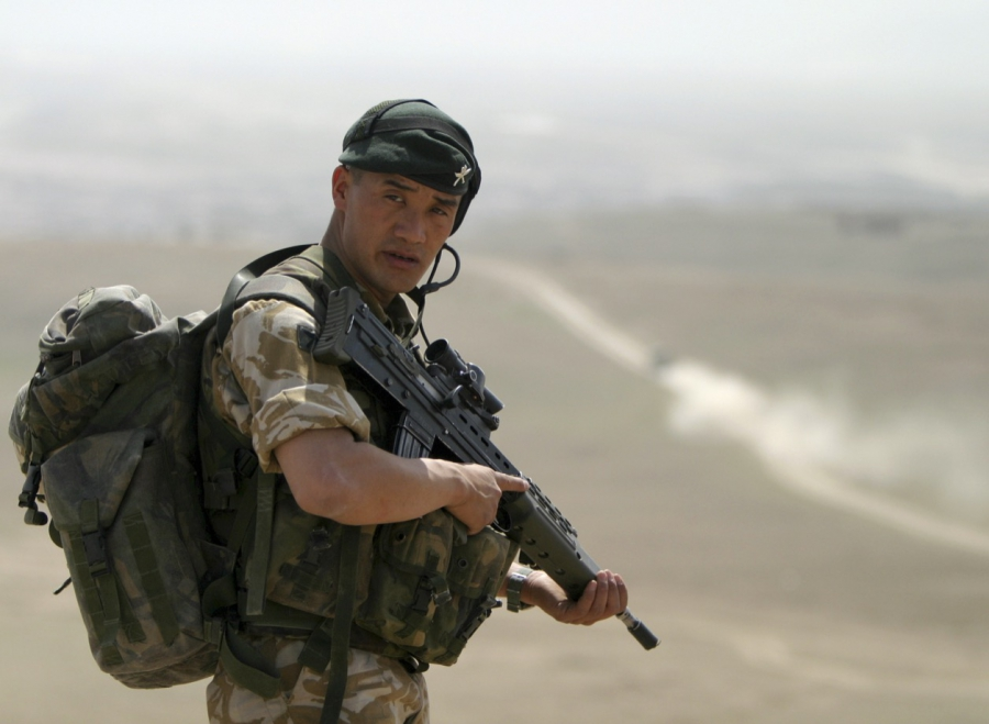 A Gurkha soldier of the British army stands guard during training in Kabul in this March 15, 2004 file photo. Ahmad Masood