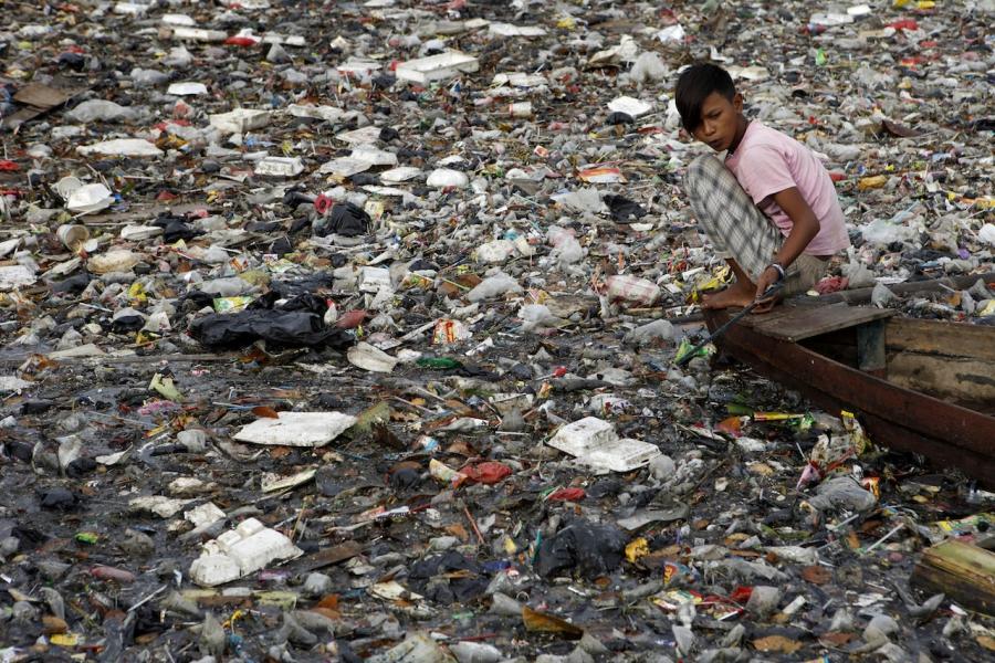 Child scavenger river plastic indonesia