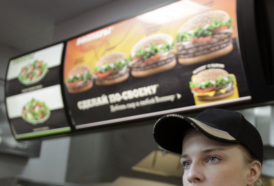 An employee at a Burger King restaurant in Moscow. One of many American companies doing business in Russia.