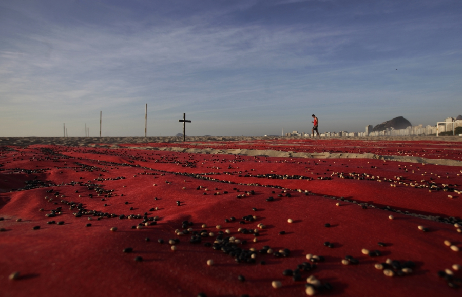 To raise awareness of the higher murder rate in Brazil, the non-governmental group Rio de Paz placed about 500,000 beans over red sheets to represent the number of people killed over the the previous 10 years in Brazil. Photo taken in Rio de Janeiro, Dec.
