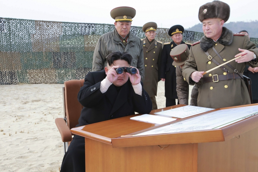 North Korean leader Kim Jong Un looks through a pair of binoculars as he guides the multiple-rocket launching drill of women's sub-units under KPA Unit 851, in this undated photo released by North Korea's Korean Central News Agency.