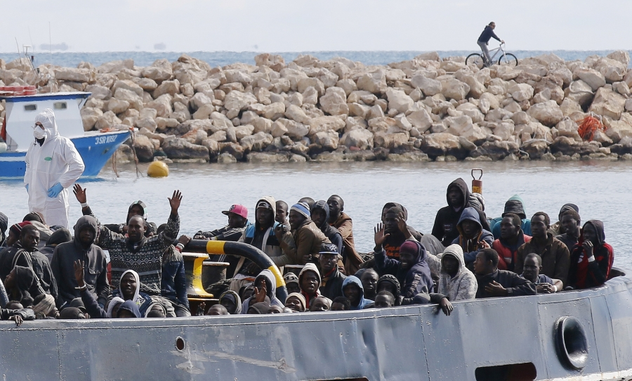Migrants arrive by boat at the Sicilian harbour of Pozzallo, February 15, 2015.
