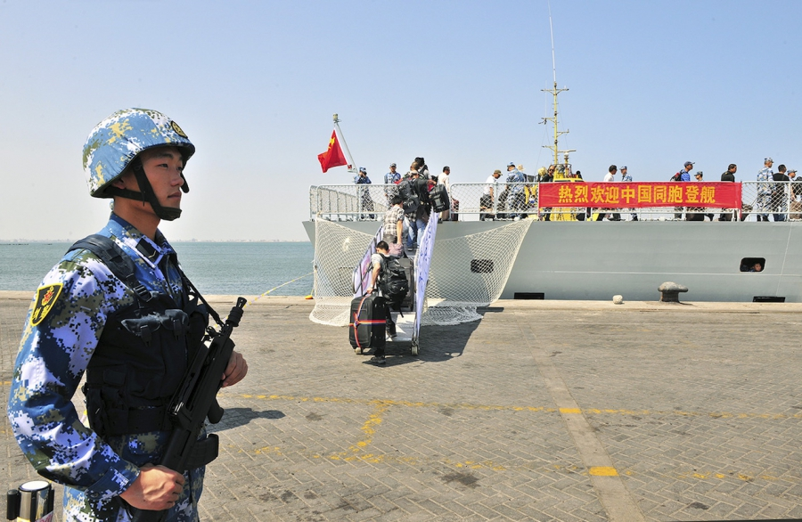 "Chinese citizens board the naval ship ""Linyi"" at a port in Aden"
