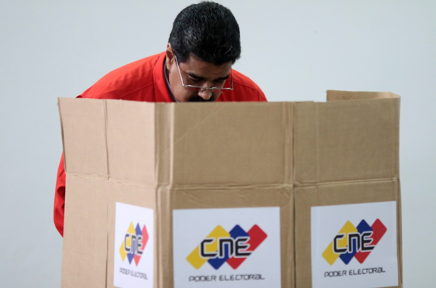 Venezuelan President Nicolas Maduro casts his vote at a polling station during the Constituent Assembly election in Caracas, Venezuela, July 30, 2017.