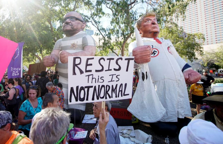 Protesters demonstrate outside President Donald Trump's campaign rally in Phoenix, Arizona, Aug. 22, 2017.