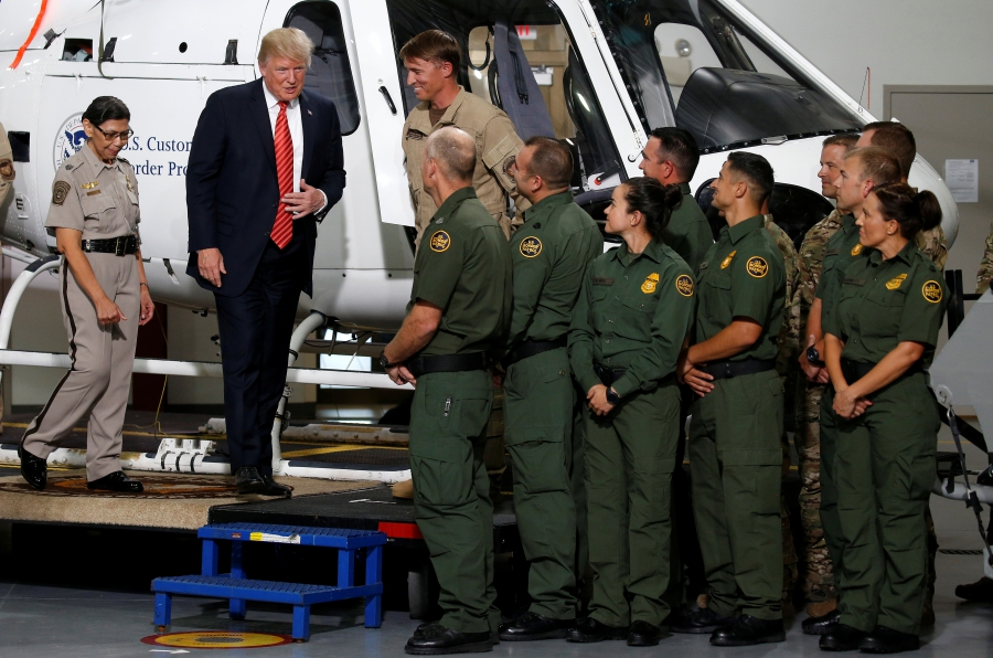 US President Donald Trump greets Border Patrol agents
