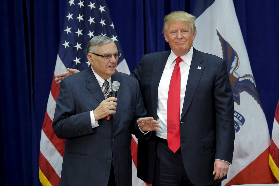 Donald Trump and Joe Arpaio appear together at a campaign rally in Marshalltown, Iowa, Jan. 26, 2016, after Arpaio endorsed Trump for president.