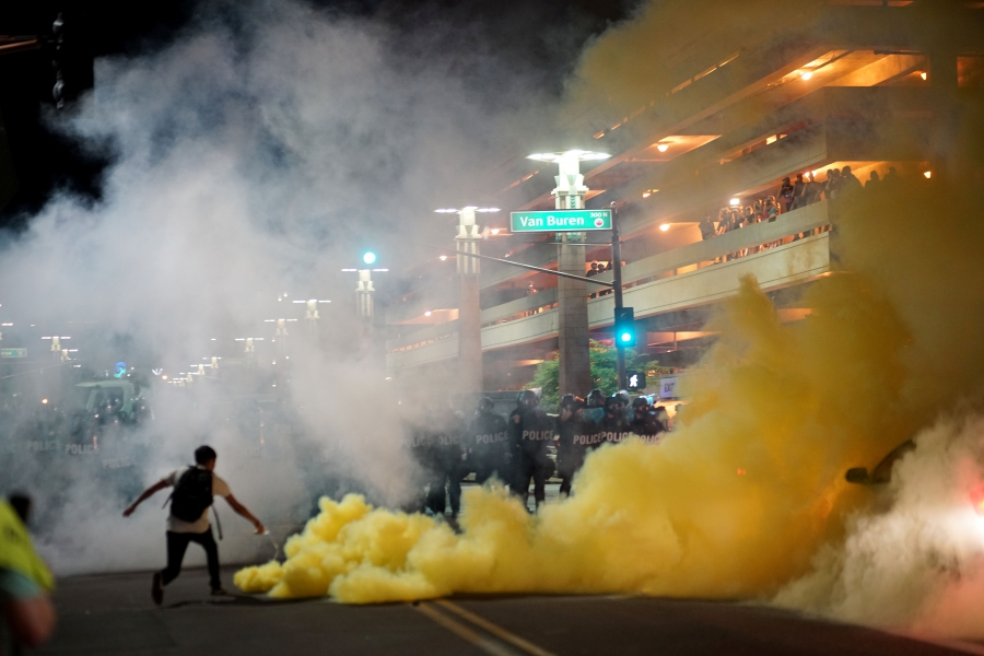 Police officials lob tear gas after President Donald Trump's campaign rally in Phoenix, Arizona, Aug. 22, 2017.