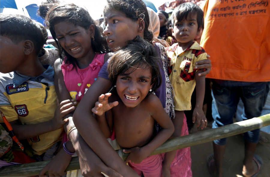 Rohingya refugees wait to receive aid in Cox's Bazar, Bangladesh, Sept. 25, 2017.