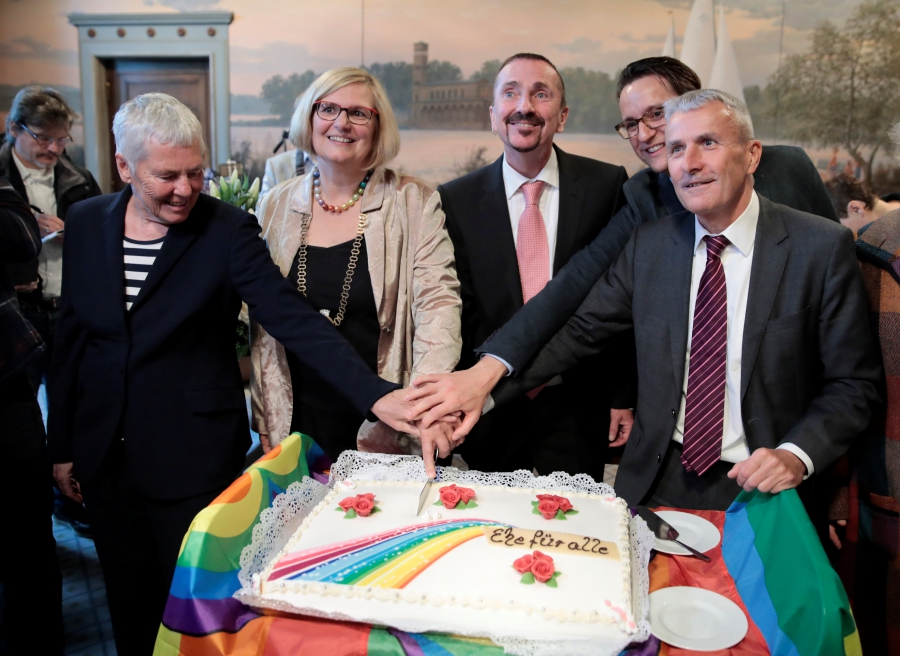 Germany's first married same-sex couple Karl Kreil and Bodo Mende cut a wedding cake after getting married.