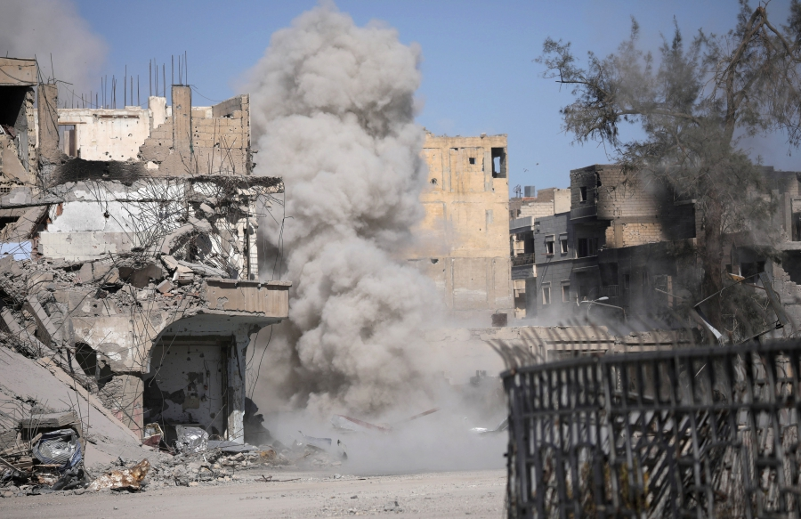 Smoke rises after a landmine exploded as fighters of Syrian Democratic Forces are clearing roads after liberation of Raqqa, Syria Oct. 18, 2017.