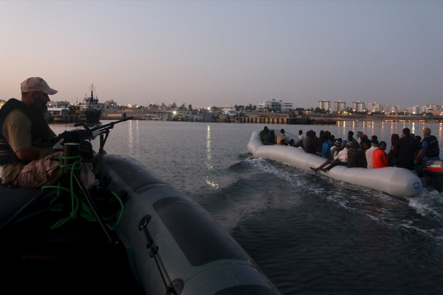 Migrants on a boat after being detained at a Libyan navy base in Tripoli.