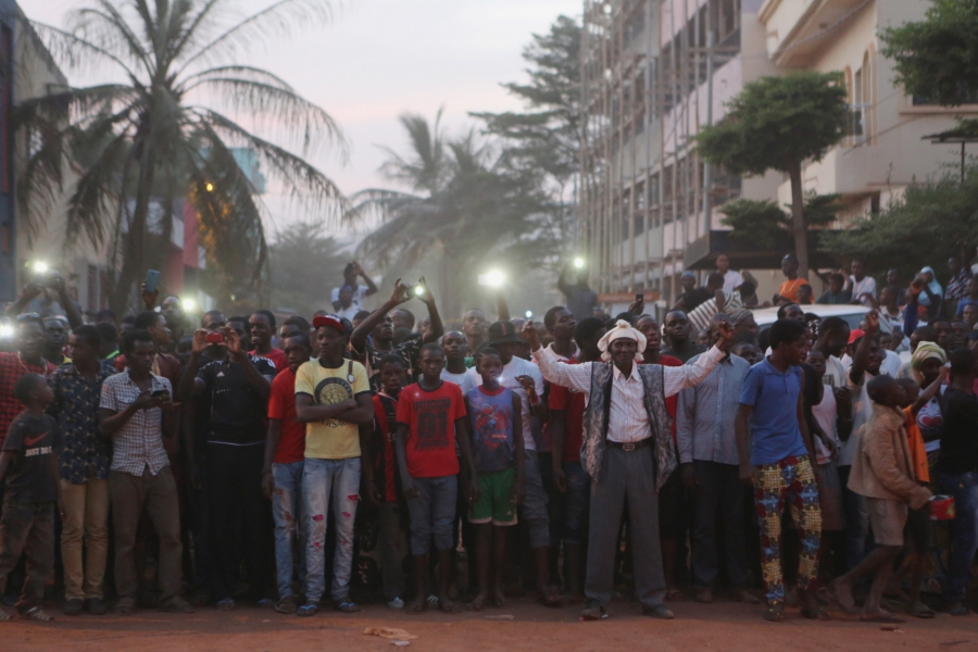 People cheer Malian soldiers in front of the Radisson hotel in Bamako, Mali, November 20, 2015.