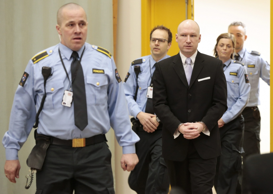 Mass killer Anders Behring Breivik is seen surrounded by prison guards on the fourth and last day in court in Skien prison, Norway March 18, 2016.
