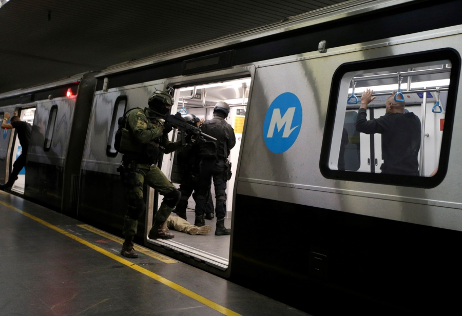 A Brazilian Marine takes part in exercises with officers of a French elite police unit in a Rio subway ahead of the Summer Olympics on June 10.