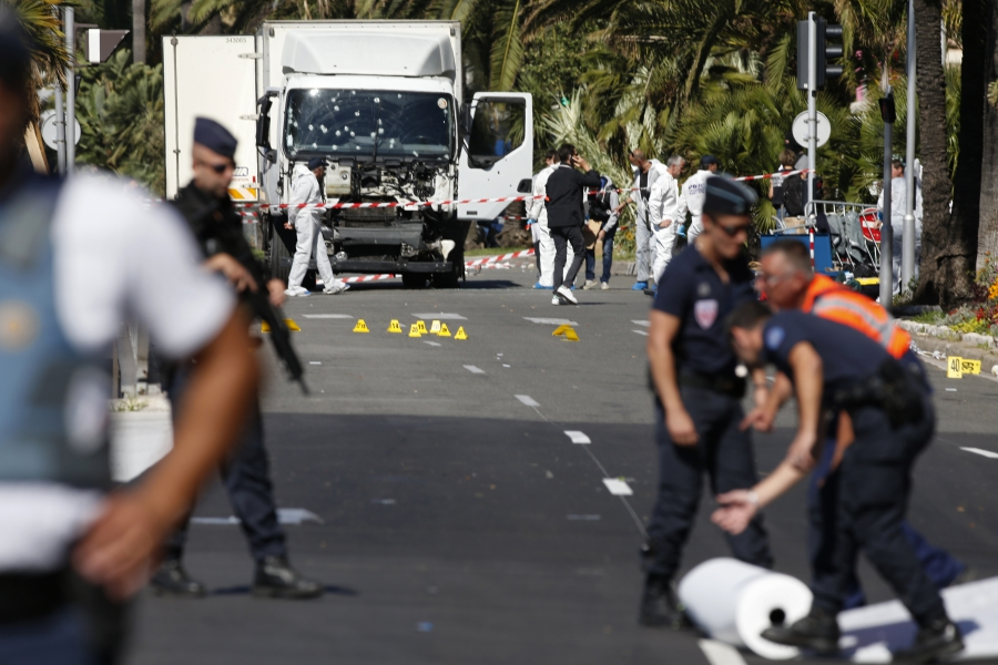 French police secure the area as the investigation continues at the scene near the heavy truck that ran into a crowd at high speed killing scores who were celebrating the Bastille Day July 14 national holiday on the Promenade des Anglais in Nice, France,