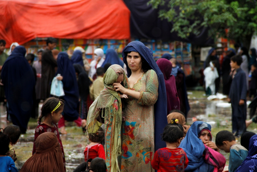 Families prepare to return to Afghanistan, at a UN refugee repatriation center in Peshawar, Pakistan, Aug. 2, 2016.