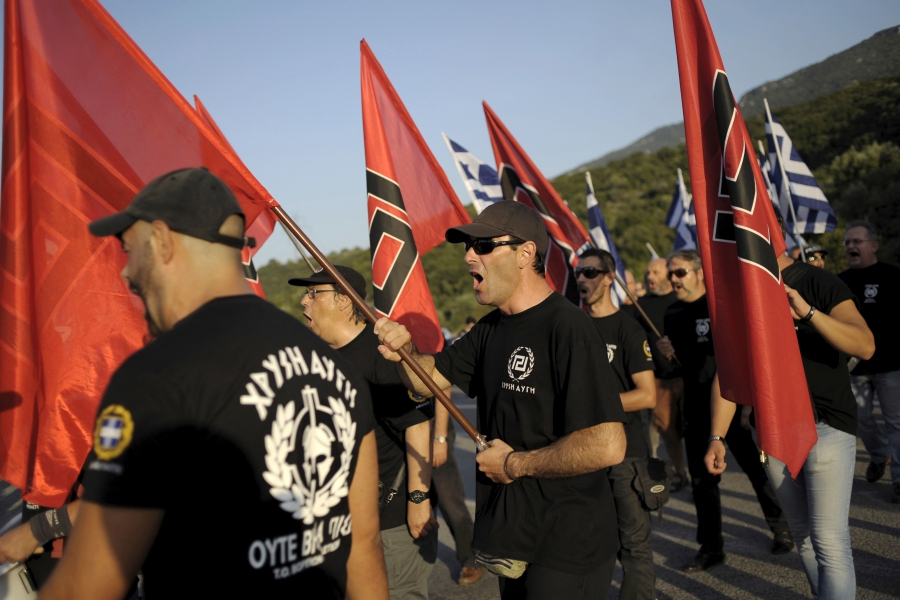 Golden Dawn supporters prepare for a rally in Thermopylae, outside Athens, Greece, Sept. 5, 2015.