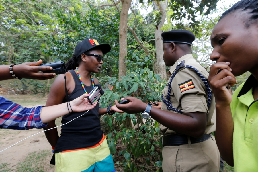 A policeman questions a demonstrator during the gay pride parade in Entebbe, near the capital city of Kampala, before police asked marchers to abandon the gathering, Sept. 24, 2016.