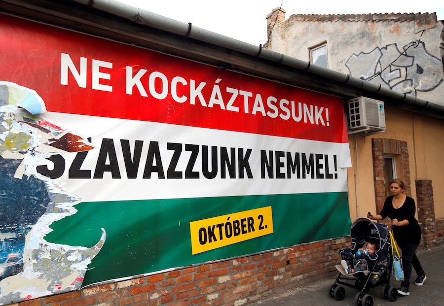 """One of the Hungarian goverment's posters campaigning for a referendum on EU migrant quotas reads """"We should not take a risk, vote no,"""" in Budapest, Hungary, on Sept. 28."""