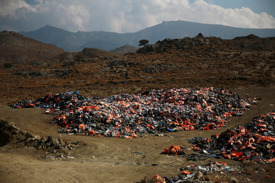 Thousands of lifejackets left by migrants and refugees are piled up at a garbage dump site near the town of Molyvos on Lesbos, Oct. 5, 2016.