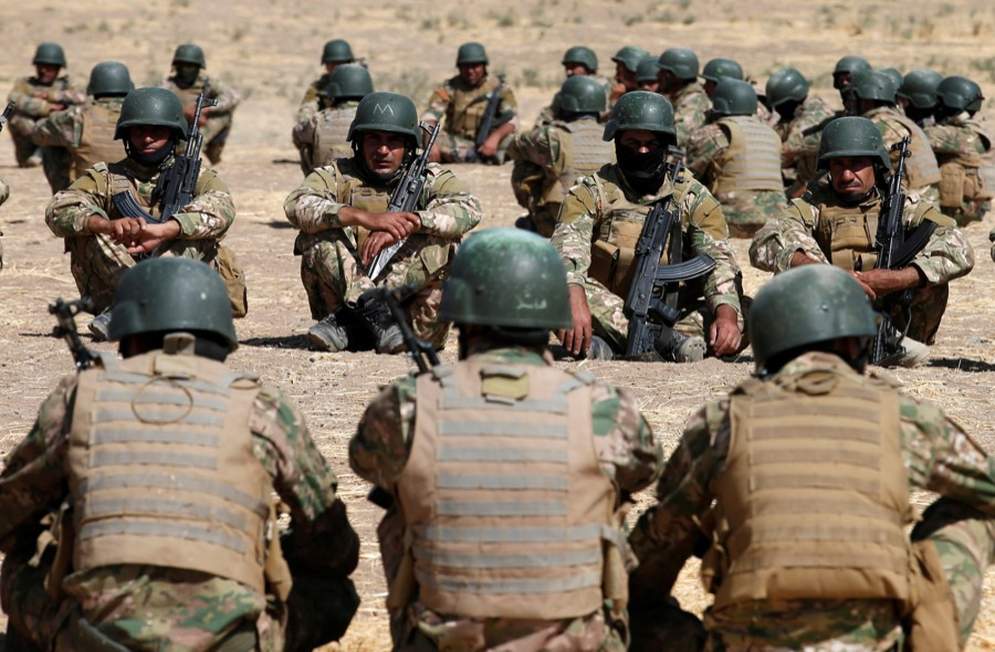 Fighters from a predominantly Sunni force take part in a training session on Oct. 6 in Bashiqa, Iraq, before the battle to recapture Mosul.