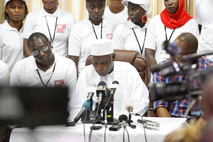 The president of Gambia's Independent Electoral Commission, Alieu Momarr Mjiar, announces presidential election results in Banjul, Gambia, December 2, 2016.