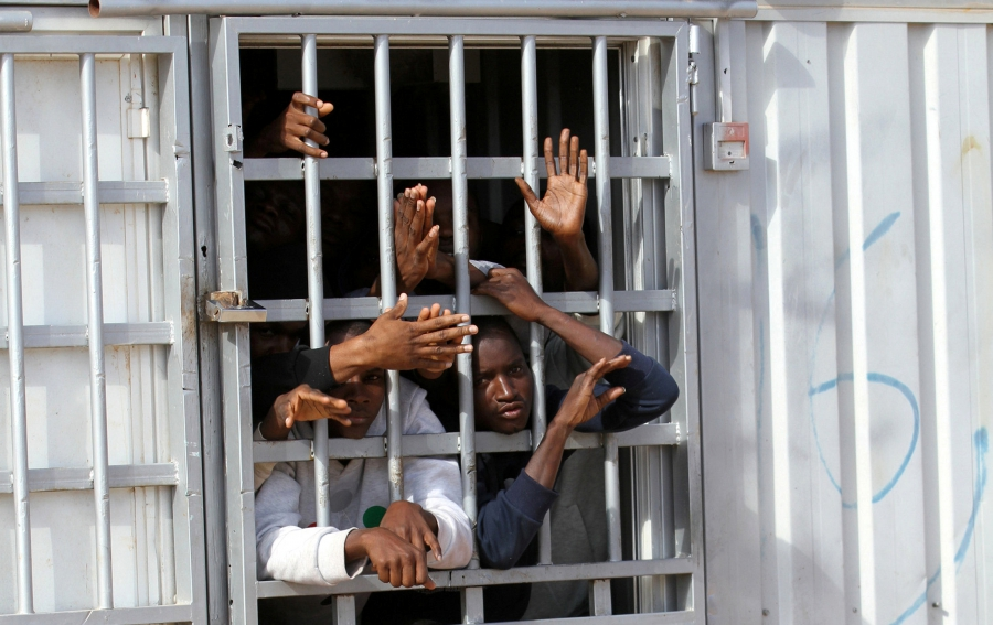 Migrants detained after trying to get to Europe wait in a detention camp in Gheryan, outside Tripoli, Libya