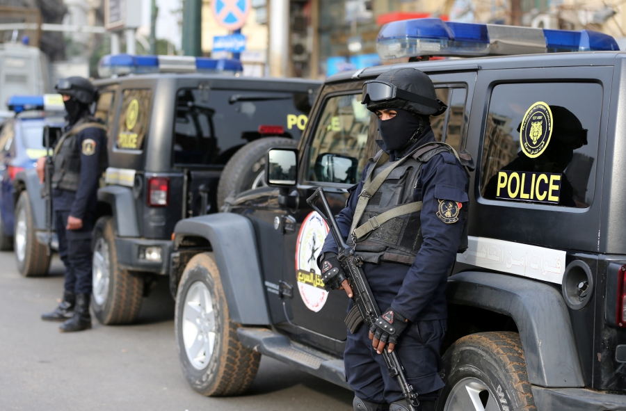 Egyptian security forces stand guard during the sixth anniversary of the 2011 uprising at Tahrir Square in Cairo, Egypt, Jan. 25, 2017.