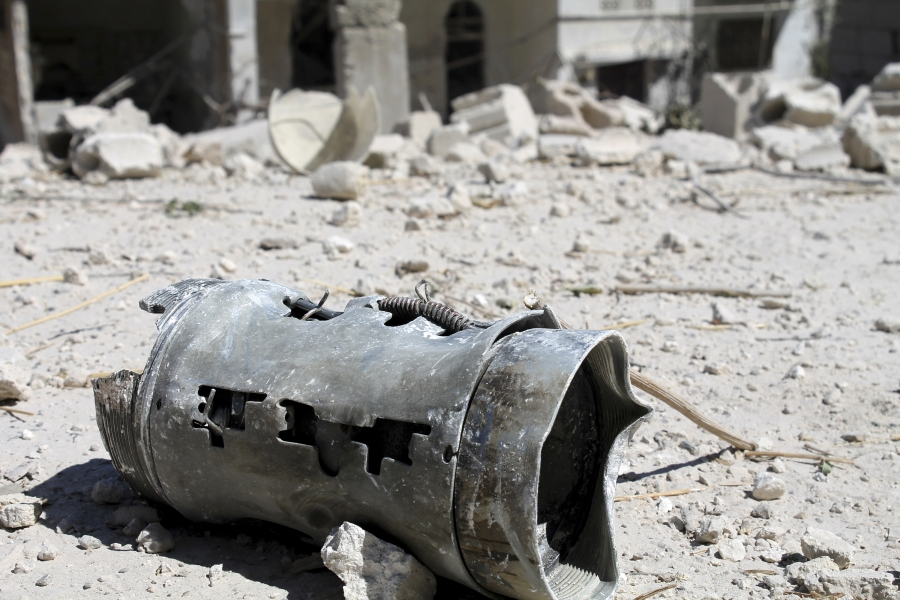 A barrel that activists said was thrown from warplanes loyal to President Bashar al-Assad in the Ariha countryside, on September 7, 2013.