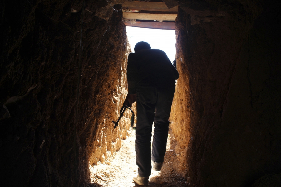 A Free Syrian Army fighter walks through a tunnel on the frontline of Eastern Ghouta, Syria, Feb. 1, 2014.