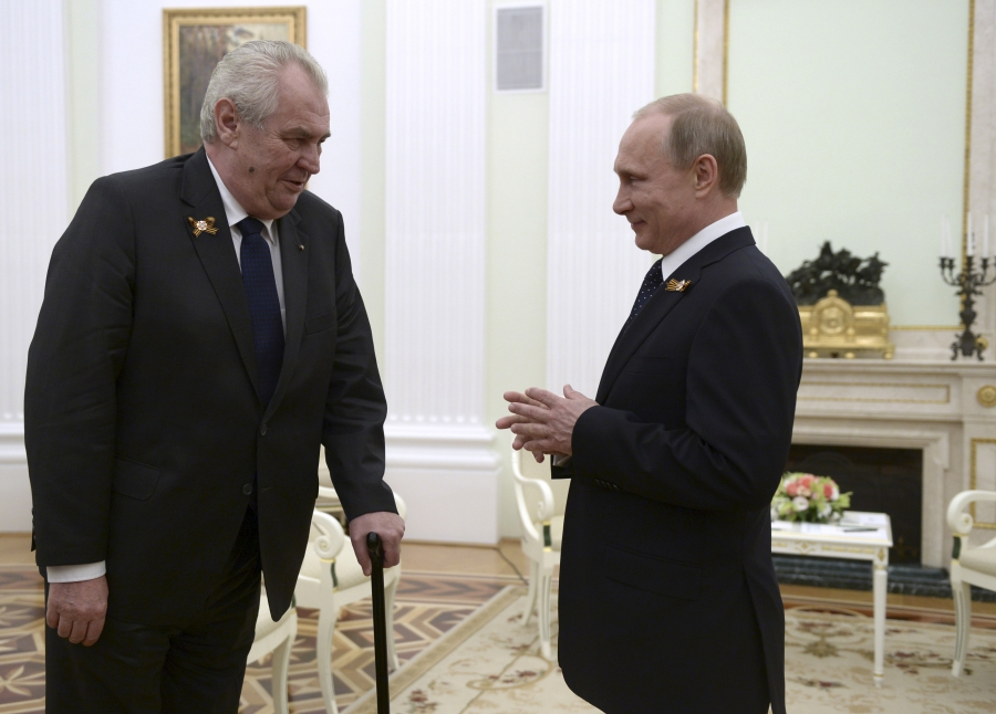 Czech President Milos Zeman, left, talks to Russian President Vladimir Putin during their meeting at the Kremlin in Moscow, Russia, on May 9, 2015.