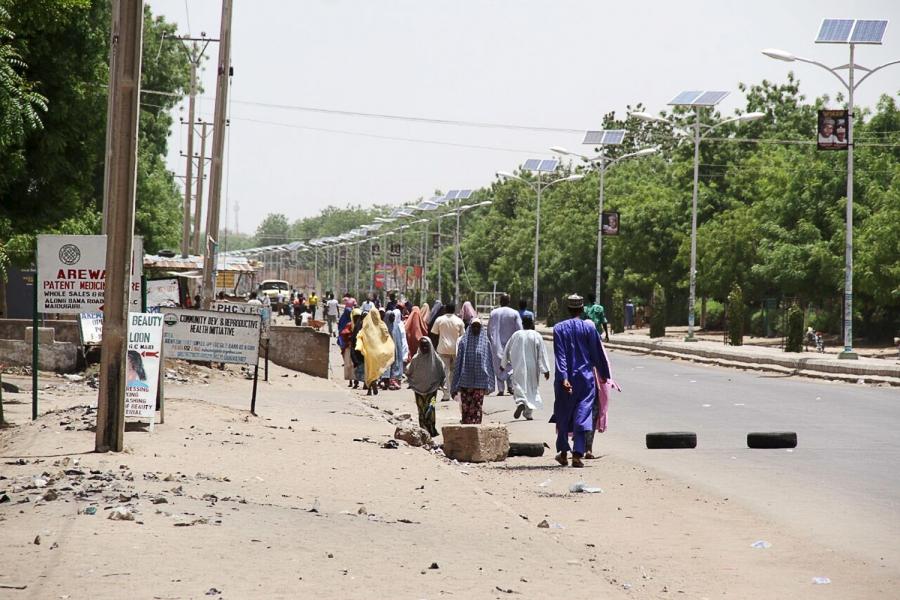 People walk along a road as they flee, in Maiduguri in Borno State, Nigeria May 14, 2015.