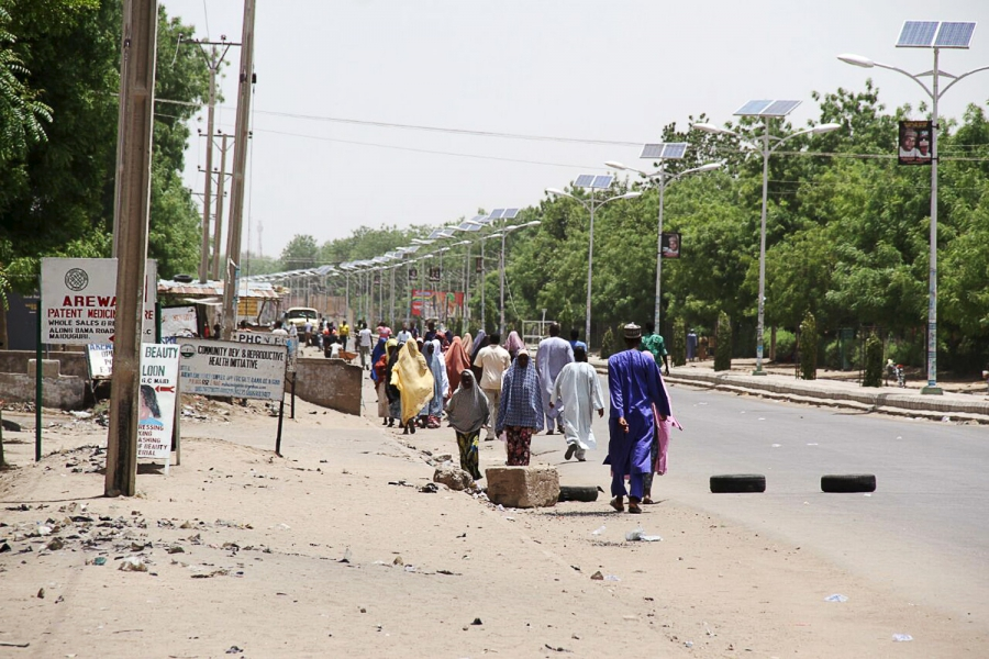 People walk along a road as they flee, in Maiduguri in Borno State, Nigeria May 14, 2015.