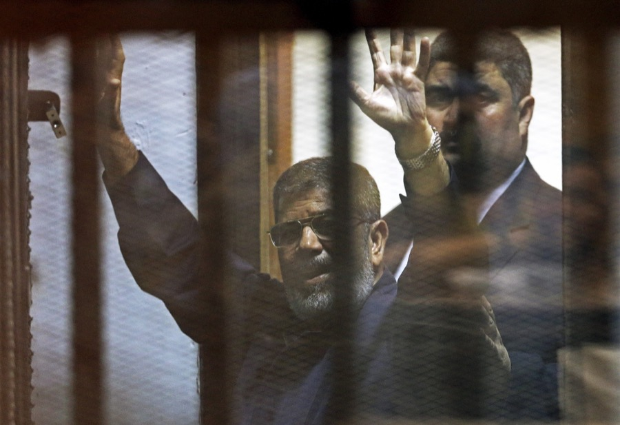 Deposed Egyptian President Mohammed Morsi behind bars after a court sentenced him to death in June 2015.