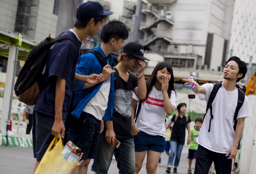 Aki Okuda (R), founding member of the Japanese protest group Students Emergency Action for Liberal Democracy (SEALDs), talks to supporters in central Tokyo, August 24, 2015.