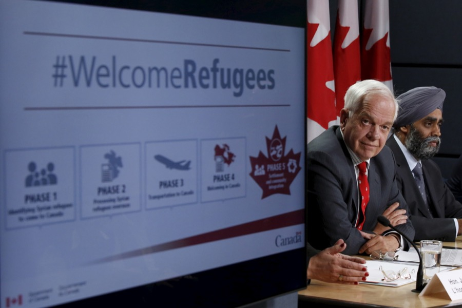 Canada's Immigration Minister John McCallum, left, and Defense Minister Harjit Sajjan speak to reporters in Ottawa, Canada on Nov. 24, 2015.