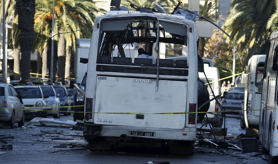 Tunisian forensics police inspect a Tunisian presidential guard bus at the scene of a suicide bomb attack in Tunis, Tunisia November 25, 2015.